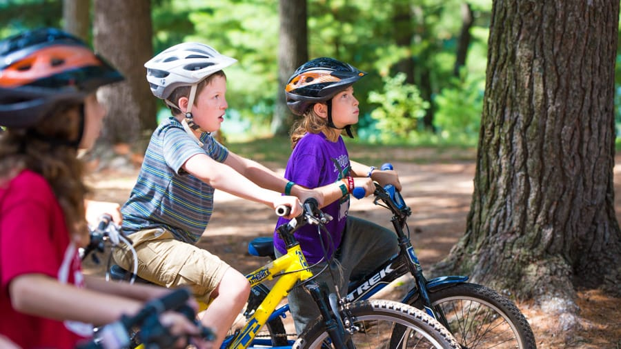 Young campers on bikes