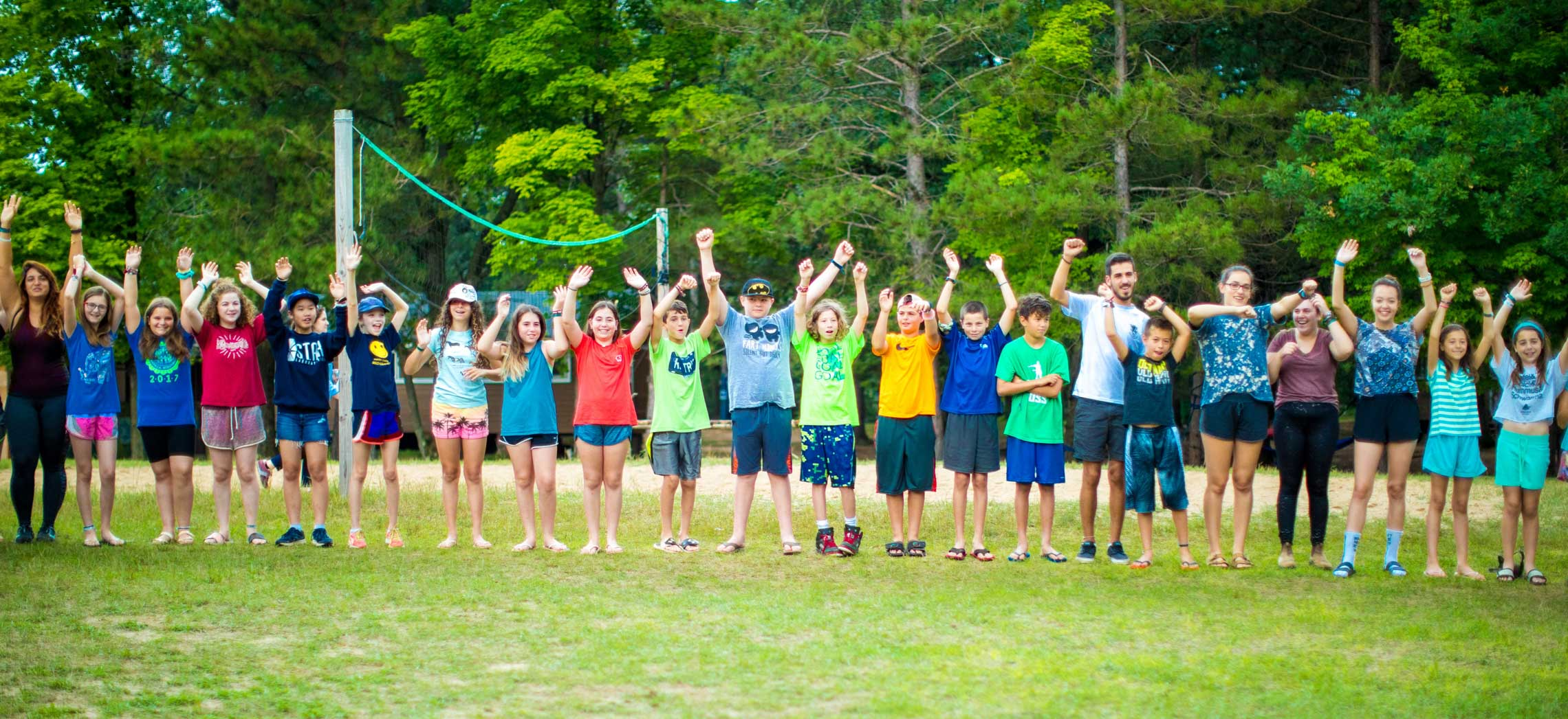 Campers with arms in air