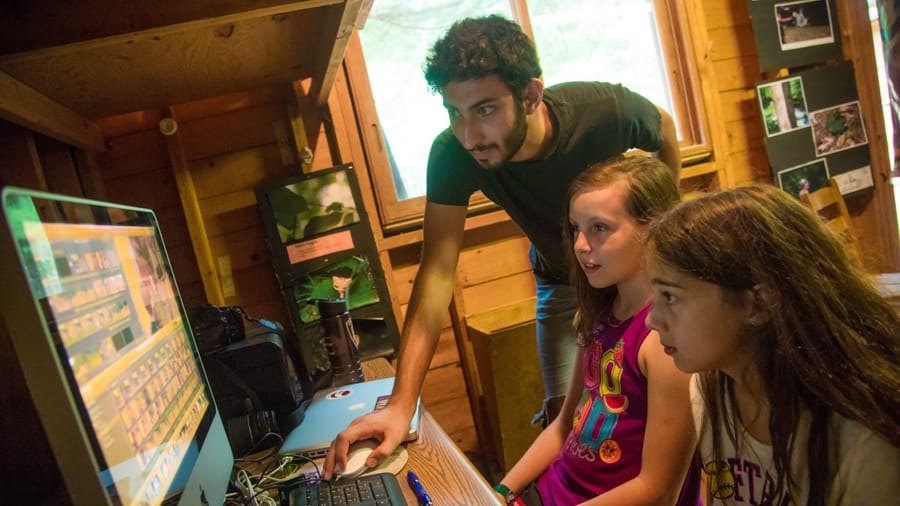 Campers learning about digital media