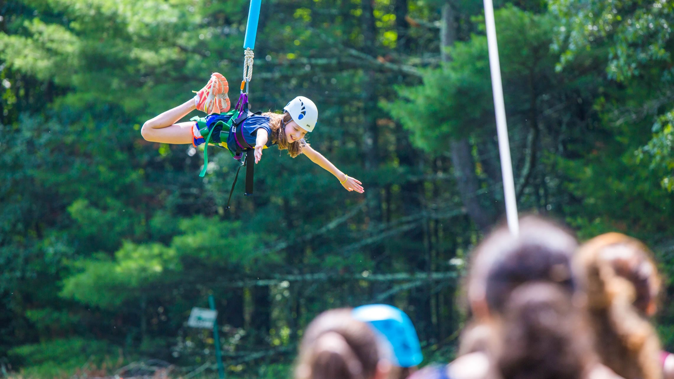 Girl descending from high ropes course