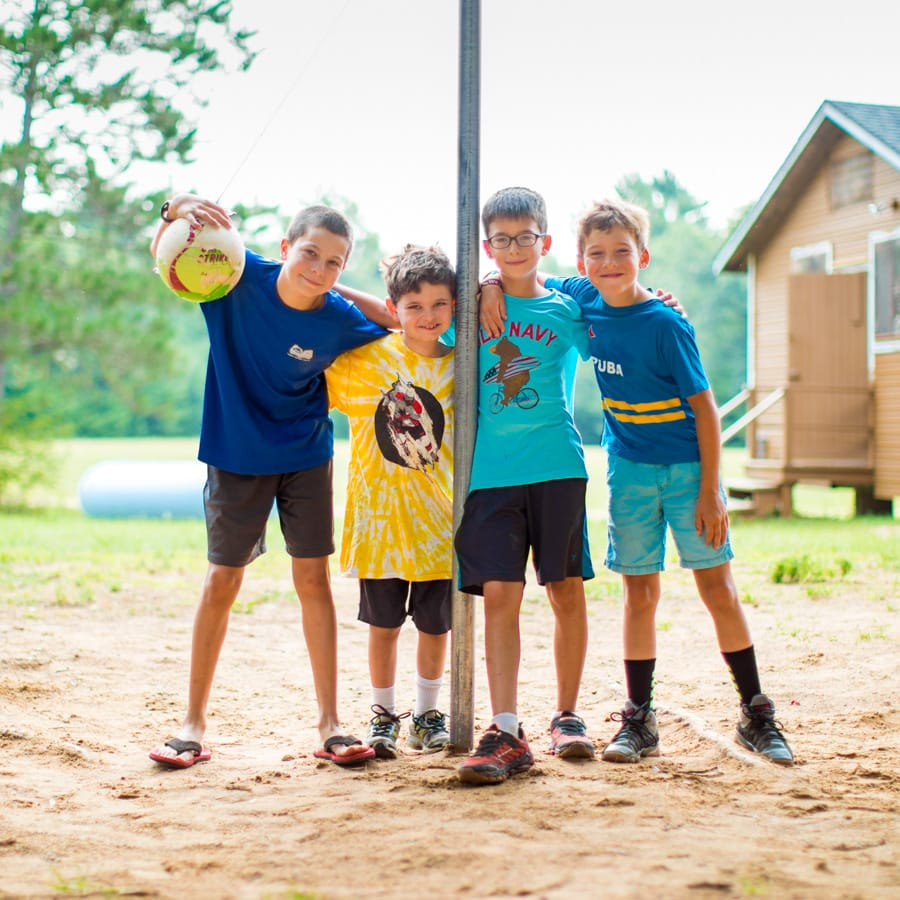Four campers with tetherball
